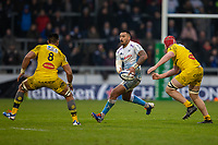 24th November 2019; AJ Bell Stadium, Salford, Lancashire, England; European Champions Cup Rugby, Sale Sharks versus La Rochelle; Denny Solomona of Sale Sharks looks to pass the ball in front of Victor Vito of La Rochelle - Editorial Use