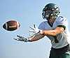 Jeremy Ruckert, standout tight end for Lindenhurst's varsity football team, poses for an action image at Venetian Shores Park on Tuesday, Aug. 22, 2017.