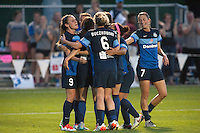 Kansas City, Mo. - Saturday April 23, 2016: FC Kansas City players celebrate a goal by FC Kansas City forward Shea Groom (2) during a match against Portland Thorns FC at Swope Soccer Village. The match ended in a 1-1 draw.