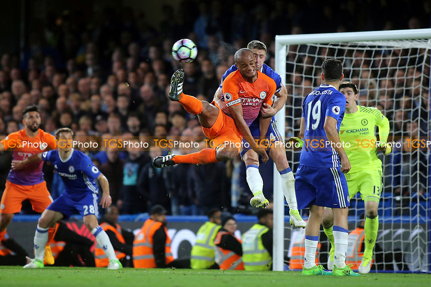 Chelsea's Gary Cahill and Vincent Kompany of Manchester City in an aerial challenge during Chelsea vs Manchester City, Premier League Football at Stamford Bridge on 5th April 2017
