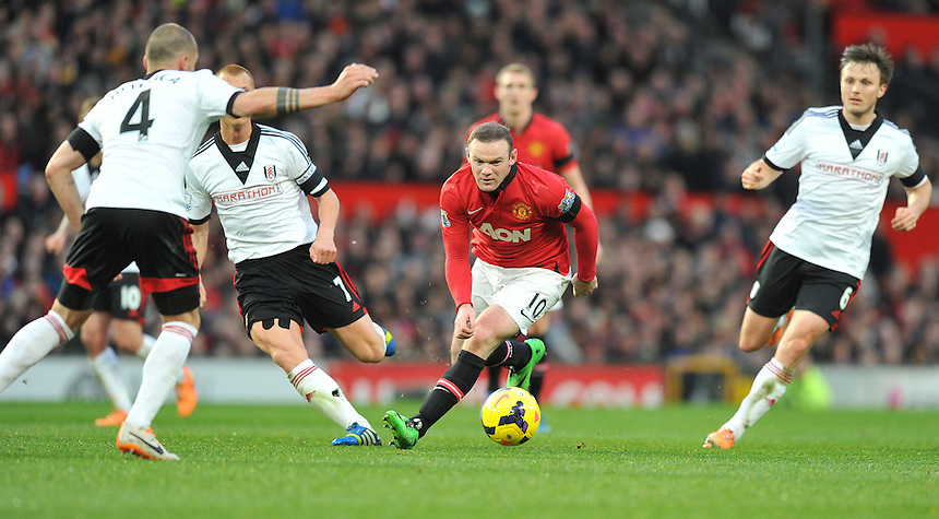 Manchester United's Wayne Rooney faces up to Fulham's John Heitinga<br /> <br /> Photo by Dave Howarth/CameraSport<br /> <br /> Football - Barclays Premiership - Manchester United v Fulham - Sunday 9th February 2014 - Old Trafford - Manchester<br /> <br /> &copy; CameraSport - 43 Linden Ave. Countesthorpe. Leicester. England. LE8 5PG - Tel: +44 (0) 116 277 4147 - admin@camerasport.com - www.camerasport.com