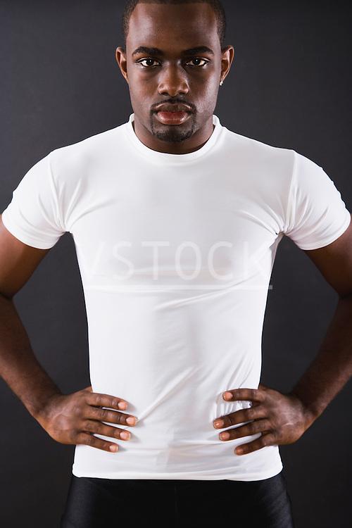 USA, Illinois, Metamora, studio portrait of young man wearing white t-shirt