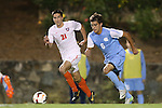 08 October 2013: North Carolina's Colton Storm (6) and Clemson's Ara Amirkhanian (21). The University of North Carolina Tar Heels hosted the Clemson University Tigers at Fetzer Field in Chapel Hill, NC in a 2013 NCAA Division I Men's Soccer match. Clemson won the game 2-1 in overtime.