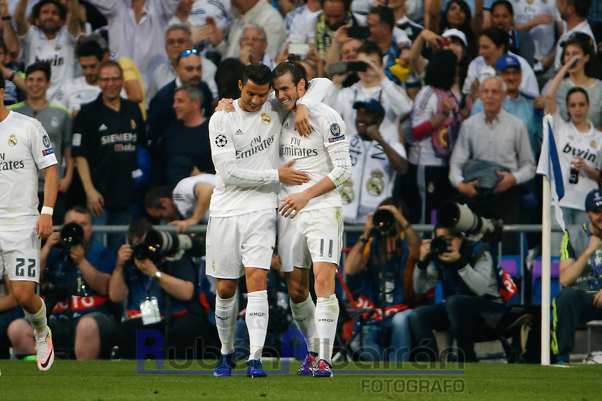 Real Madrid´s Welsh forward Gareth Bale and  Cristiano Ronaldo celebrating during the UEFA Champions League match between Real Madrid and Manchester City at the Santiago Bernabeu Stadium in Madrid, Wednesday, May 4, 2016.