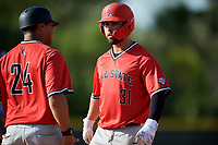 Ball State Cardinals first baseman John Ricotta (31) and first base coach Blake Beemer (24) during a game against the Mount St. Mary's Mountaineers on March 9, 2019 at North Charlotte Regional Park in Port Charlotte, Florida.  Ball State defeated Mount St. Mary's 12-9.  (Mike Janes/Four Seam Images)