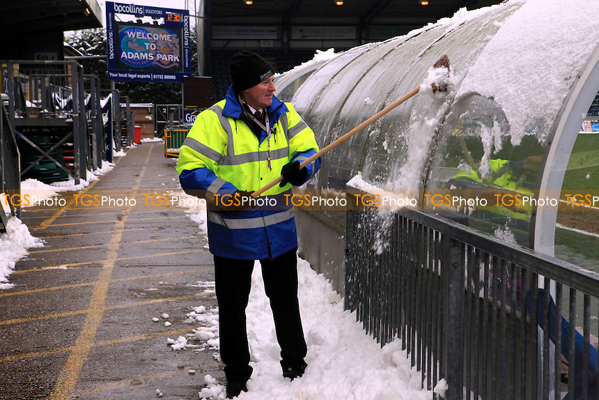 A member of the Wycombe groundstaff clears the home dug-out of snow - Wycombe Wanderers vs Dagenham & Redbridge - NPower League Two Football at Adams Park, High Wycombe - 19/01/13 - MANDATORY CREDIT: Paul Dennis/TGSPHOTO - Self billing applies where appropriate - 0845 094 6026 - contact@tgsphoto.co.uk - NO UNPAID USE.