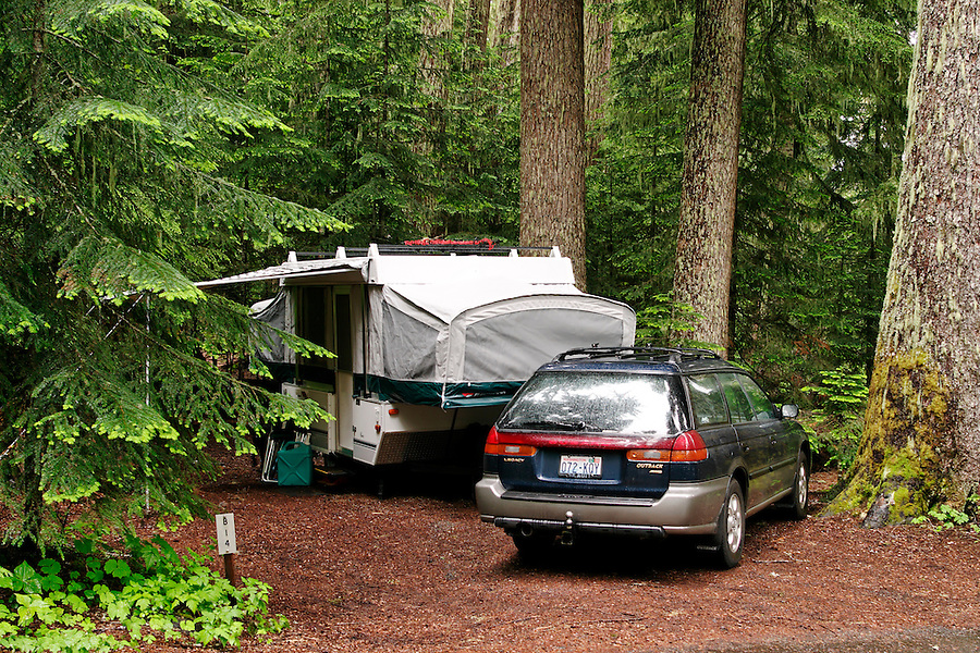 Car and tent trailer in forested campsite, White River Campground, Mount Rainier National Park, Washington, USA