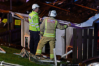 Pictured: Fire service personnel and gas board engineers assess the damaged building in the Waunceirch area of Neath, Wales, UK. Monday 14 January 2018<br /> Re: Four flats have been evacuated after an explosion in Neath at 8:30pm on Monday.<br /> Extensive damage was caused to Waun Las, in the Waunceirch area and arrangements made to house its residents until the building is deemed safe.<br /> One woman was taken to hospital with serious burn injuries which are not believed to be life threatening.<br /> A joint investigation is under way between South Wales Police and the fire service to determine the cause.<br /> Wales and West Utilities said the gas supply to the affected property had been isolated.