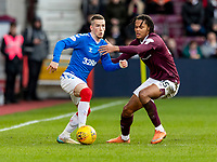 26th January 2020, Tynecastle Park, Edinburgh, Scotland; Scottish Premier League football, Hearts of Midlothian versus Rangers; Toby Sibbick of Hearts grapples with Ryan Kent of Rangers