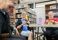 NWA Democrat-Gazette/CHARLIE KAIJO Connie Rogers of Bella Vista, Joan Abrams of Bella Vista and Earlen Taylor of Bella Vista share a laugh while stitching at the Bella Vista Public Library in Bella Vista, AR on Monday, September 11, 2017. The good humored group B'Creative Stitchers meets at the library every Monday. They started two years ago. It's a group for friends to meet, check on face book and gossip, Connie Rogers of Bella Vista joked.