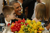 United States President Barack Obama (2-L) smiles with Makenna Hurd (front R) of Mascot, Tennessee, and Noah Koch (L) of Waterville, Maine, during the second annual 'Kids' State Dinner', in the East Room of the White House in Washington DC, USA, 09 July 2013. The 'State Dinner' features a selection of winning recipes and recognizes fifty-four winners representing all US states, three territories and the District of Columbia.<br /> Credit: Michael Reynolds / Pool via CNP