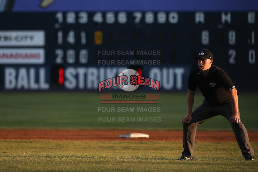 Umpire Andy Stukel at work during a game between the Vancouver Canadians and the Tri-City Dust Devils at Nat Bailey Stadium on July 23, 2015 in Vancouver, British Columbia. Tri-City defeated Vancouver, 6-4. (Larry Goren/Four Seam Images)
