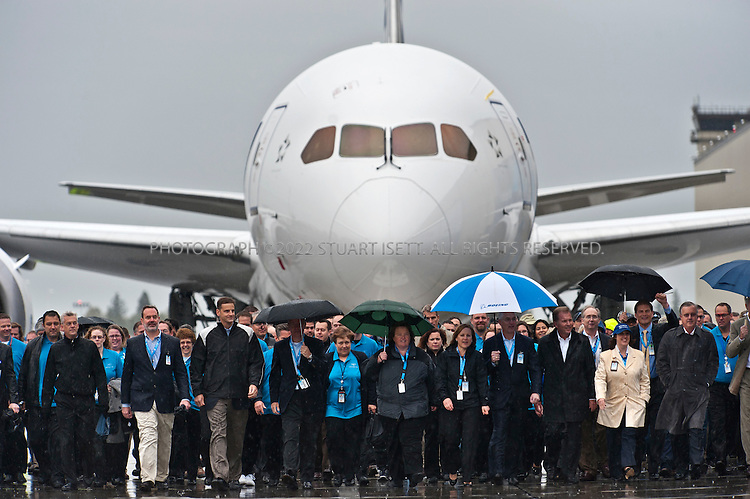 9/26/2011--Everett, WA, USA..Hundreds of employees for Boeing Co. walk towards the main  stage,leading the company's first 787 Dreamliner to be delivered...Thousands of Boeing employees gathered in the rain to celebrate the delivery of the first 787 Dreamliner to launch customer ANA (All Nippon Airways) from Japan. The fuel efficient composite aircraft was towed to the front of the huge factory doors where it was assembled, and presented to ANA President Shinichiro Ito in front of thousands of invited dignitaries and Boeing workers. The first 787 was supposed to be delivered 3 years ago but despite delays Boeing still has orders for over 800 of the planes...©2011 Stuart Isett. All rights reserved.