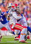 9 November 2014: Buffalo Bills Buffalo Bills defensive tackle Marcell Dareus takes down Kansas City Chiefs quarterback Alex Smith with a fourth quarter sack at Ralph Wilson Stadium in Orchard Park, NY. The Chiefs rallied with two fourth quarter touchdowns to defeat the Bills 17-13. Mandatory Credit: Ed Wolfstein Photo *** RAW (NEF) Image File Available ***