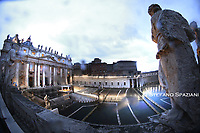 """VATICAN CITY, VATICAN - MARCH 27: A general view of St. Peter's Square as Pope Francis attends an extraordinary moment of prayer in time of pandemic, the adoration of the Blessed Sacrament and delivers an extraordinary """"Urbi Et Orbi"""" (to the City of Rome and to the World) Blessing in front of an empty Square from the sagrato of St. Peter's Basilica, on March 27, 2020 in Vatican City, Vatican. The """"Salus Populi Romani"""" icon and the crucifix of St. Marcellus, are placed in front of the central door of St. Peter's Basilica. Vatican Media broadcasted the ceremony live to the world and it could also be followed in several languages on Facebook and YouTube."""