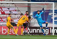 Lincoln City's Josh Vickers punches clear under pressure from Northampton Town's Andy Williams<br /> <br /> Photographer Chris Vaughan/CameraSport<br /> <br /> Emirates FA Cup First Round - Lincoln City v Northampton Town - Saturday 10th November 2018 - Sincil Bank - Lincoln<br />  <br /> World Copyright © 2018 CameraSport. All rights reserved. 43 Linden Ave. Countesthorpe. Leicester. England. LE8 5PG - Tel: +44 (0) 116 277 4147 - admin@camerasport.com - www.camerasport.com