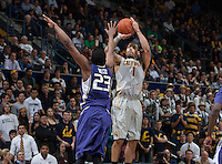 Justin Cobbs of California shoots the ball during the game against Washington at Haas Pavilion in Berkeley, California on January 15th 2014.  California defeated Washington, 82-56.