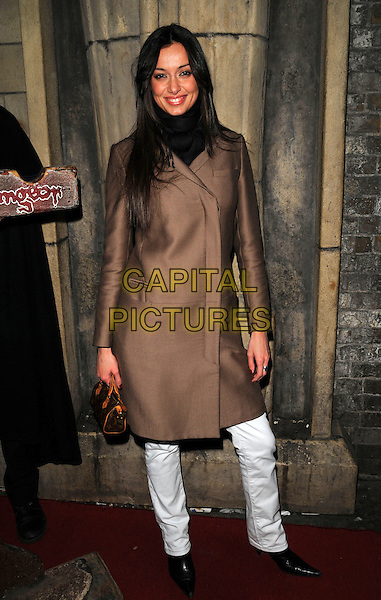 LAURA ESPOSITO.The Jack The Ripper Experience launch party, London Dungeon, London, England..April 6th, 2008.full length brown coat white jeans denim louis vuitton bag purse.CAP/CAN.©Can Nguyen/Capital Pictures