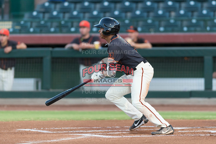 AZL Giants Black right fielder Randy Norris (1) starts down the first base line during an Arizona League game against the AZL Rangers at Scottsdale Stadium on August 4, 2018 in Scottsdale, Arizona. The AZL Giants Black defeated the AZL Rangers by a score of 6-3 in the second game of a doubleheader. (Zachary Lucy/Four Seam Images)