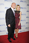 BEVERLY HILLS, CA- OCTOBER 23: Actress Sienna Miller (R) and Executive Chairman of NYLON, Mark Luzzatto arrive at the International Medical Corps' Annual Awards dinner ceremony at the Beverly Wilshire Four Seasons Hotel on October 23, 2014 in Beverly Hills, California.