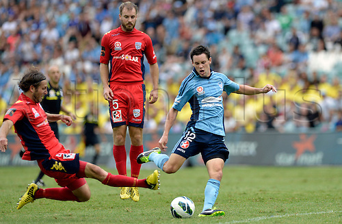 16.02.2013 Sydney, Australia.Sydney forward Blake Powell and Adelaide defender Jon McKain in action during the Hyundai A League game between Sydney FC and Adelaide United from the Allianz Stadium.