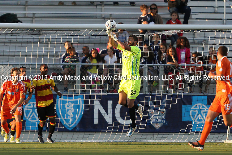 20 April 2013: Fort Lauderdale's Matt Glaeser (center) punches the ball. The Carolina RailHawks played the Fort Lauderdale Strikers at WakeMed Stadium in Cary, North Carolina in a North American Soccer League Spring 2013 Season regular season game.