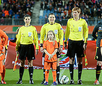 20140212 - ZWOLLE , THE NETHERLANDS : Ukraine referees Kateryna Monzul (m) , Natalia Rachynska and Maryna Striletska pictured during the female soccer match between The Netherlands and Belgium , on the fifth matchday in group 5 of the UEFA qualifying round to the FIFA Women World Cup in Canada 2015 at Het Ijseldelta Stadion , Zwolle . Wednesday 12th February 2014 . PHOTO DAVID CATRY