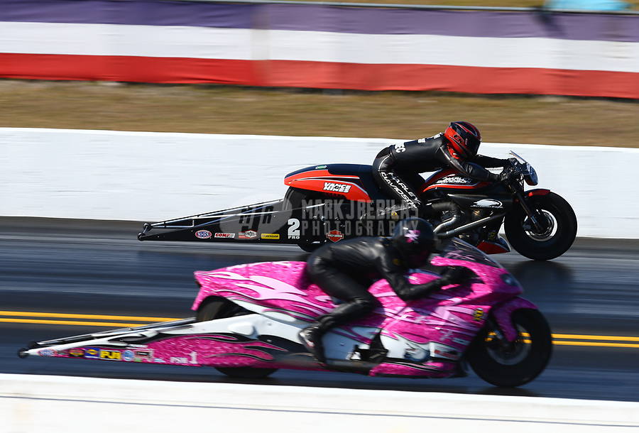 Mar 18, 2017; Gainesville , FL, USA; NHRA pro stock motorcycle rider Eddie Krawiec (far) races alongside Jerry Savoie during qualifying for the Gatornationals at Gainesville Raceway. Mandatory Credit: Mark J. Rebilas-USA TODAY Sports