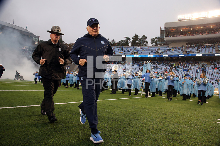 CHAPEL HILL, NC - NOVEMBER 23: Head coach Mack Brown of the University of North Carolina jogs onto the field during a game between Mercer University and University of North Carolina at Kenan Memorial Stadium on November 23, 2019 in Chapel Hill, North Carolina.