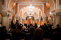 Australian violinist Niki Vasilakis speaks to her audience before she plays the violin during a recital at the OzFest Gala Dinner in the Jaipur City Palace, in Rajasthan, India on 10 January 2013. Photo by Suzanne Lee