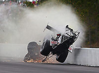 Mar 14, 2015; Gainesville, FL, USA; NHRA top fuel dragster driver Larry Dixon crashes and goes airborne after his car broke in half during qualifying for the Gatornationals at Auto Plus Raceway at Gainesville. Dixon walked away from the incident. Mandatory Credit: Mark J. Rebilas-
