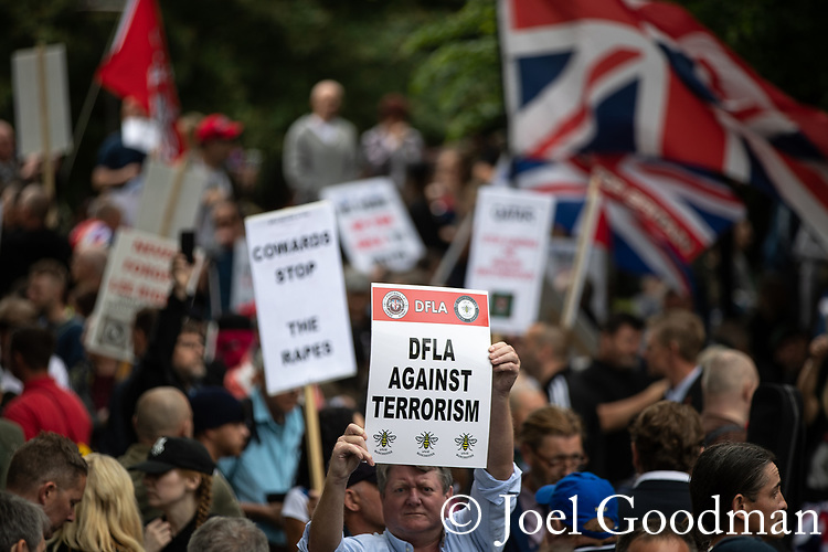 © Joel Goodman - 07973 332324 . 02/06/2018. Manchester, UK. Approximately 1,000 DFLA supporters gather in All Saints Park . The Democratic Football Lads Alliance demonstrate in Manchester , eleven days after the first anniversary of the Manchester Arena terror attack . Photo credit : Joel Goodman