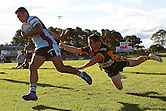 Sosaia Feki of the Cronulla Sharks escapes a tackle from Grant Nelson of the Wyong Roos during Round 5 of the 2013 NSW Cup at Morrie Breen Oval on April 7, 2013 in Wyong, Australia. (Photo by Paul Barkley/LookPro)
