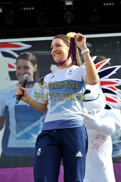 Dani King.Gold Medal Winner for Team GB, attending BT London Live, Hyde Park, London, England. .5th August 2012.cyclist half length white t-shirt blue tracksuit medal microphone athlete.CAP/MAR.© Martin Harris/Capital Pictures.