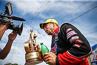 Jul 10, 2016; Joliet, IL, USA; NHRA pro stock driver Greg Anderson celebrates after winning the Route 66 Nationals at Route 66 Raceway. Mandatory Credit: Mark J. Rebilas-USA TODAY Sports