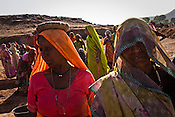 Women seen at a site as part of NREGA at Nazir ka Mandir in Karauli district of Rajasthan, India. The National Rural Employment Guarantee Act (NREGA) that has created a source of additional income for families living below the poverty line by providing a minimum 100 days of employment assured under the Act. Photo by Sanjit Das