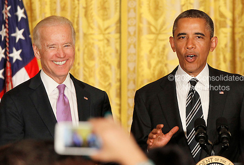 United States President Barack Obama and U.S. Vice President Joe Biden attend the LGBT Pride Month celebration in the East Room at the White House on June 13, 2013.  <br /> Credit: Molly Riley / Pool via CNP