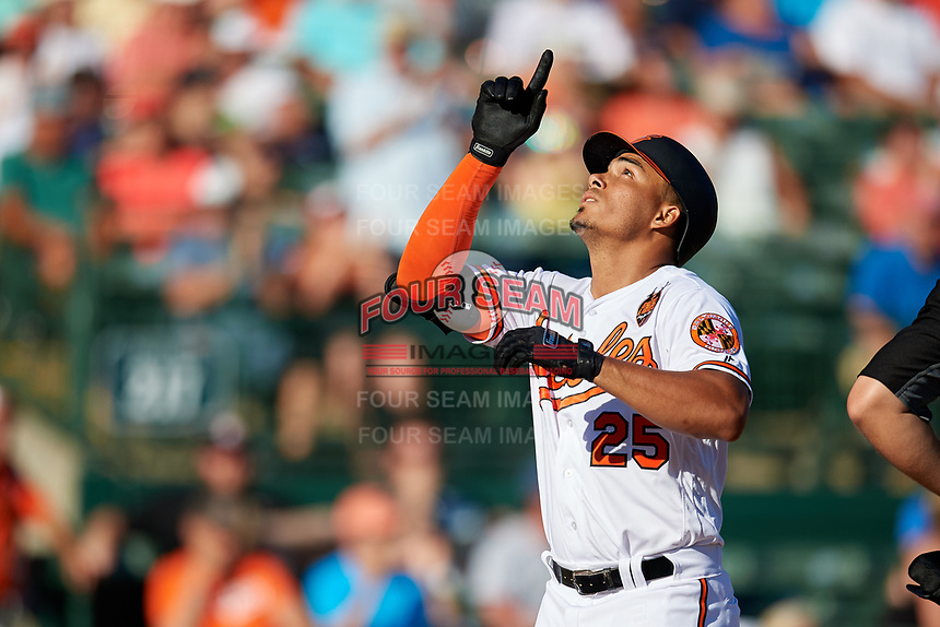 Baltimore Orioles designated hitter Anthony Santander (25) points skyward as he crosses home plate after hitting a home run in the bottom of the fourth inning during a Grapefruit League Spring Training game against the Detroit Tigers on March 3, 2019 at Ed Smith Stadium in Sarasota, Florida.  Baltimore defeated Detroit 7-5.  (Mike Janes/Four Seam Images)