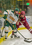 20 February 2016: University of Vermont Catamount Forward Craig Puffer, a Freshman from New Canaan, CT, is checked by Boston College Eagle Defenseman Michael Kim, a Freshman from Toronto, Ontario, during the second period at Gutterson Fieldhouse in Burlington, Vermont. The Eagles defeated the Catamounts 4-1 in the second game of their weekend series. Mandatory Credit: Ed Wolfstein Photo *** RAW (NEF) Image File Available ***