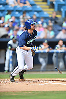Asheville Tourists shortstop Ryan Vilade (4) swings at a pitch during game one of a double header against the Columbia Fireflies at McCormick Field on August 4, 2018 in Asheville, North Carolina. The Tourists defeated the Fireflies 5-1. (Tony Farlow/Four Seam Images)