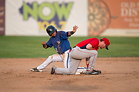 Missoula Osprey shortstop Brandon Leyton (12) asks the umpire to call time after sliding safely into second base ahead of Justin Jones' (33) tag during a Pioneer League game against the Orem Owlz at Ogren Park Allegiance Field on August 19, 2018 in Missoula, Montana. The Missoula Osprey defeated the Orem Owlz by a score of 8-0. (Zachary Lucy/Four Seam Images)