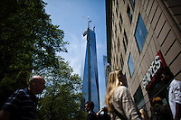 People walk near the World Trade Center while it has reached 1,776 feet, what makes it, the tallest building in the Western Hemisphere in New York,  May 10, 2013, Photo by Eduardo Munoz Alvarez / VIEWpress.