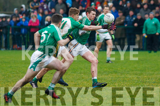 Ballydonoghue's Brian O'Seanachain putting Ballyduff's Jack O'Sullivan under pressure during their North Kerry football championship final.