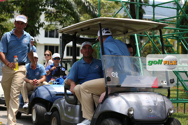 Team Europe's Thomas Bjorn (DEN) take a deserved buggy ride after thrashing Team Asia 5-0 during the first day FourBall matches at the 2014 Eurasia Cup presented by DRB-Hicom, at the Glenmarie Golf & Country Club, Kuala Lumpur, Malaysia. Picture:  David Lloyd / www.golffile.ie