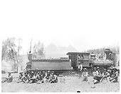 Rio Grande &amp; Pagosa Springs Railroad engine with many workmen seated on ground beside engine and engineer in window.<br /> Rio Grande &amp; Pagosa Springs    ca 1899