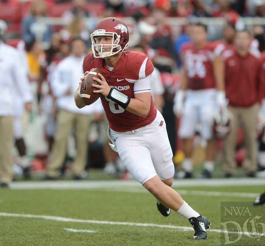 STAFF PHOTO ANTHONY REYES &bull; @NWATONYR<br /> Austin Allen, Razorbacks quarterback, rolls out to pass against Nicholls State in the fourth quarter Saturday, Sept. 6, 2014 at Razorback Stadium in Fayetteville. The Hogs won 73-7.