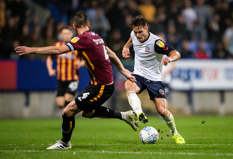 Bolton Wanderers' Dennis Politic (right) competing with Bradford City's Paudie O'Connor <br /> <br /> Photographer Andrew Kearns/CameraSport<br /> <br /> EFL Leasing.com Trophy - Northern Section - Group F - Bolton Wanderers v Bradford City -  Tuesday 3rd September 2019 - University of Bolton Stadium - Bolton<br />  <br /> World Copyright © 2018 CameraSport. All rights reserved. 43 Linden Ave. Countesthorpe. Leicester. England. LE8 5PG - Tel: +44 (0) 116 277 4147 - admin@camerasport.com - www.camerasport.com