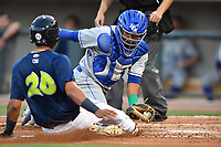Ali Sanchez (20) of the Columbia Fireflies is out at home as catcher Meibrys Viloria (4) of the Lexington Legends has the tag ready in a game on Friday, April 21, 2017, at Spirit Communications Park in Columbia, South Carolina. Columbia won, 5-0. (Tom Priddy/Four Seam Images)