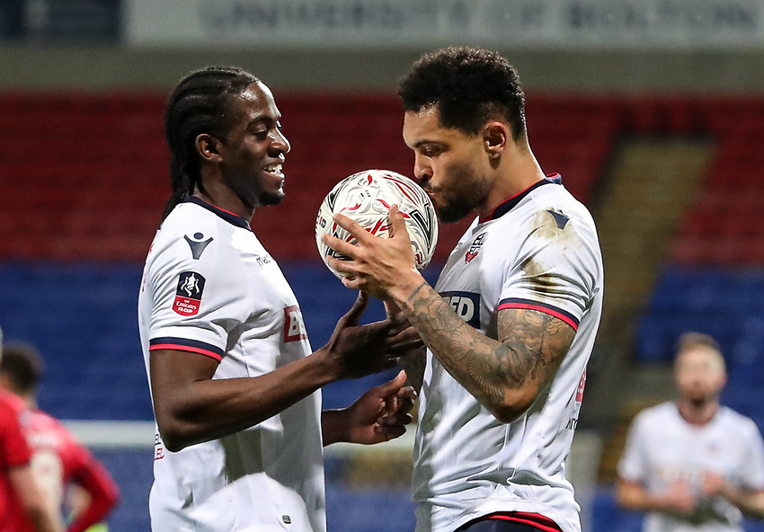 Bolton Wanderers' Josh Magennis kisses the match ball after completing his hat trick as team mate Clayton Donaldson looks on<br /> <br /> Photographer Andrew Kearns/CameraSport<br /> <br /> Emirates FA Cup Third Round - Bolton Wanderers v Walsall - Saturday 5th January 2019 - University of Bolton Stadium - Bolton<br />  <br /> World Copyright © 2019 CameraSport. All rights reserved. 43 Linden Ave. Countesthorpe. Leicester. England. LE8 5PG - Tel: +44 (0) 116 277 4147 - admin@camerasport.com - www.camerasport.com