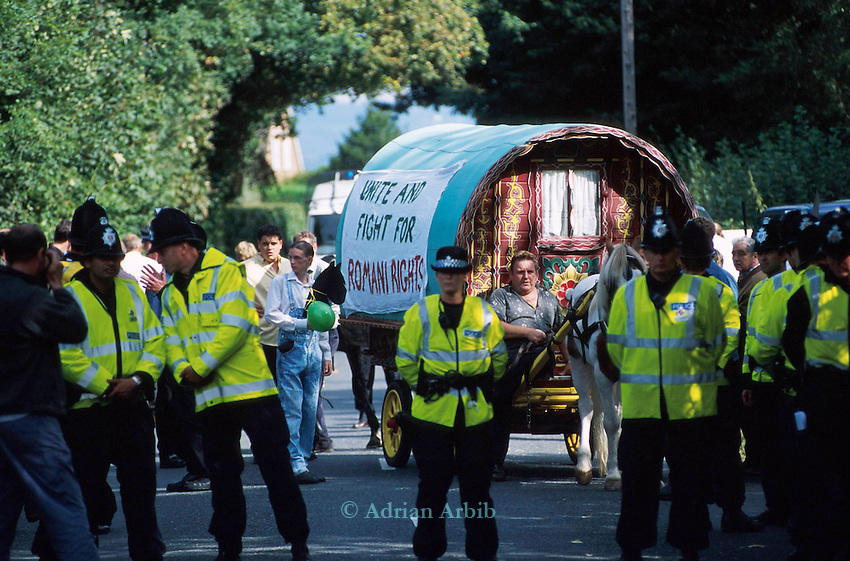 Romanies queue up at a  road  block in  Horsmandean Kent, having  been prevented access to the green in the centre  of the town.   After 300 years the  horsefair was stopped by hundreds of police in riot gear.  <br />